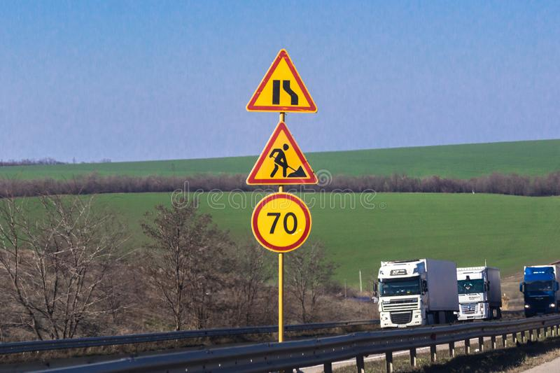 Yellow warning signs on inter-city highway. Straight road. Straight highway. Bilateral movement. Dividing line. Car country traffic. Travelling by car. Intercity royalty free stock images