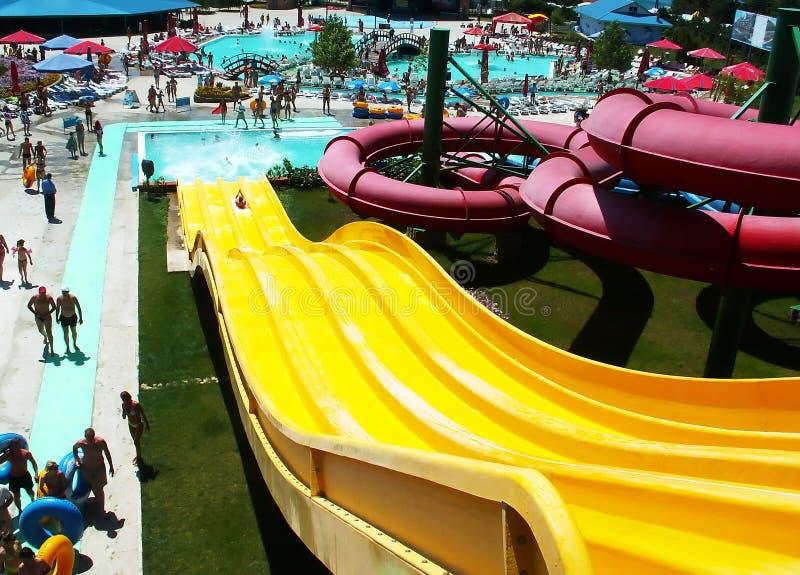 Yellow Water Slide. In aqua park stock photo
