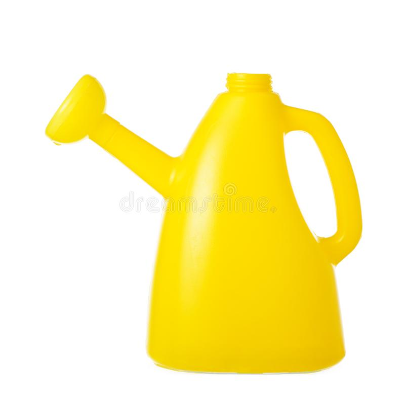 Yellow watering can isolated stock images
