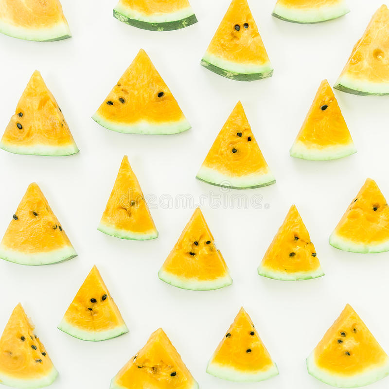 Yellow watermelon on white background. Flat lay. royalty free stock images
