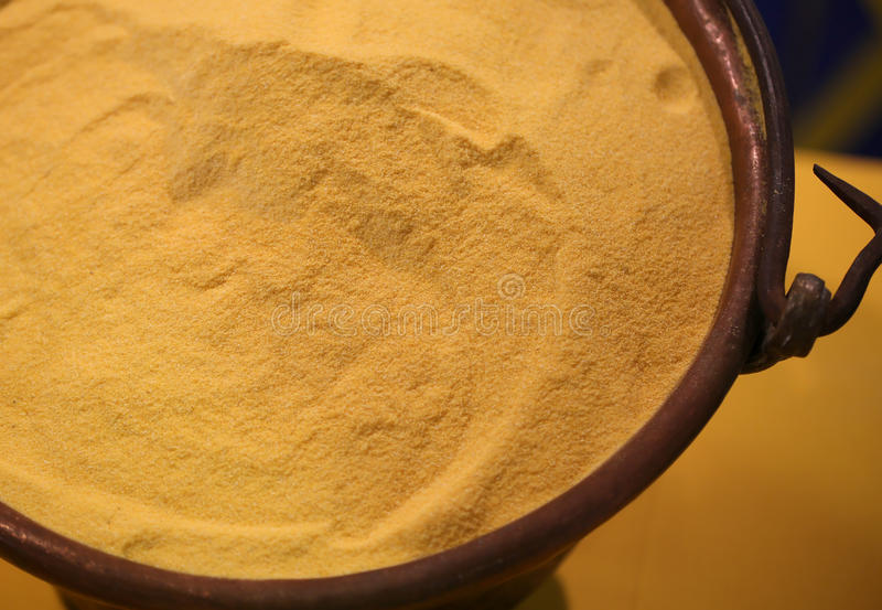 Yellow wheat flour in the old copper pail. Yellow flour in the old copper pail stock photos
