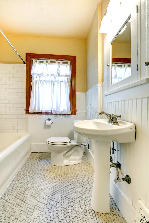 White Bathroom With Wood Tile Floor