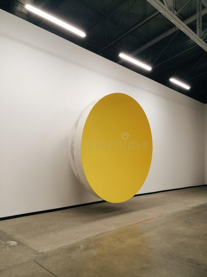 Yellow and White Bowl on Wall stock photography