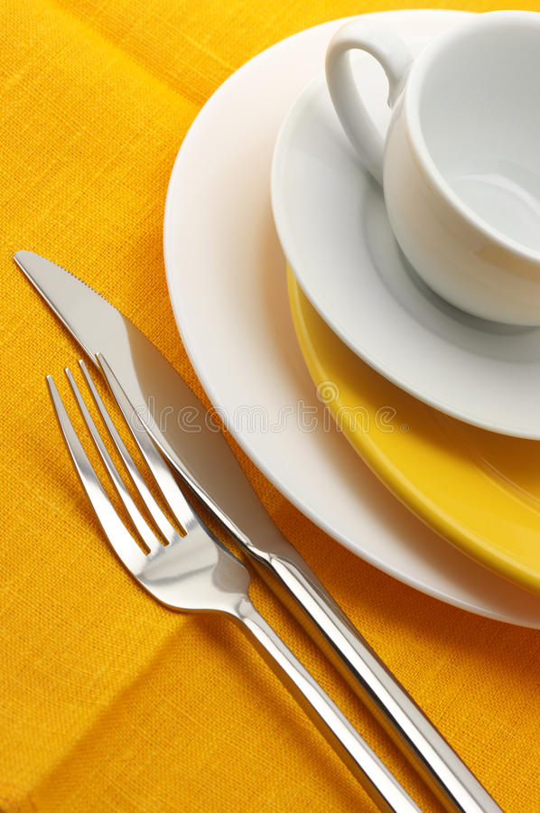 Download Yellow and white dishware stock photo. Image of knife - 13509380