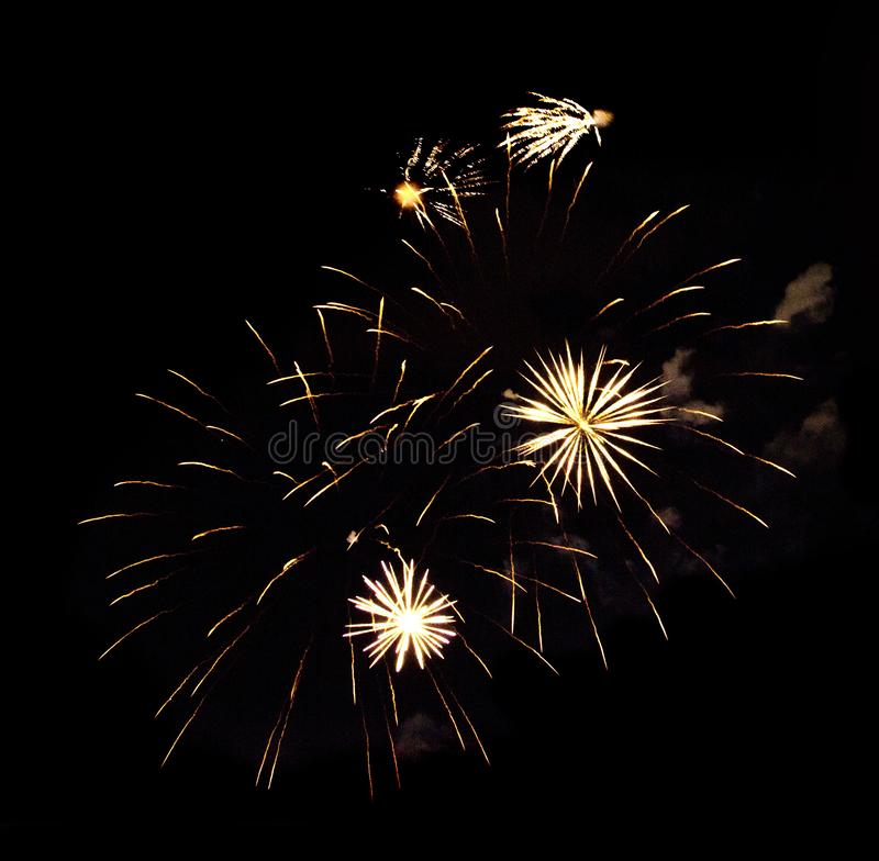 Yellow and white fireworks isolated on black background stock photos