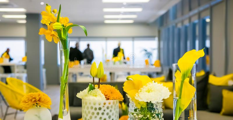 Yellow and White Flower Display for decor at corporate event royalty free stock photos