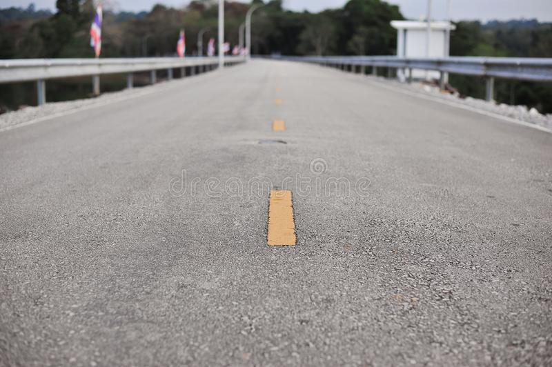 Yellow and white line on highway road is the direction of lane f. The yellow and white line on highway road is the direction of lane for safety travel stock photo