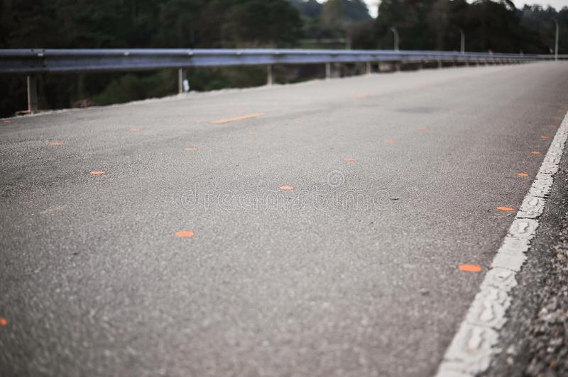 Yellow and white line on highway road is the direction of lane f. The yellow and white line on highway road is the direction of lane for safety travel stock image