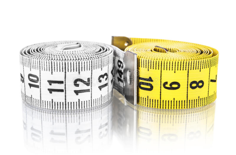 Yellow and white measuring tape royalty free stock photos