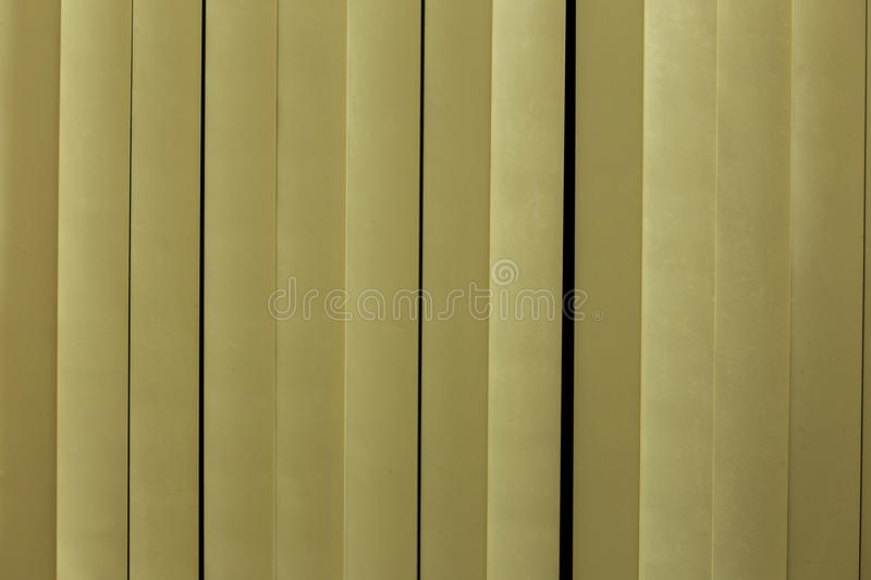 Yellow white plastic strips curtain. stock photography
