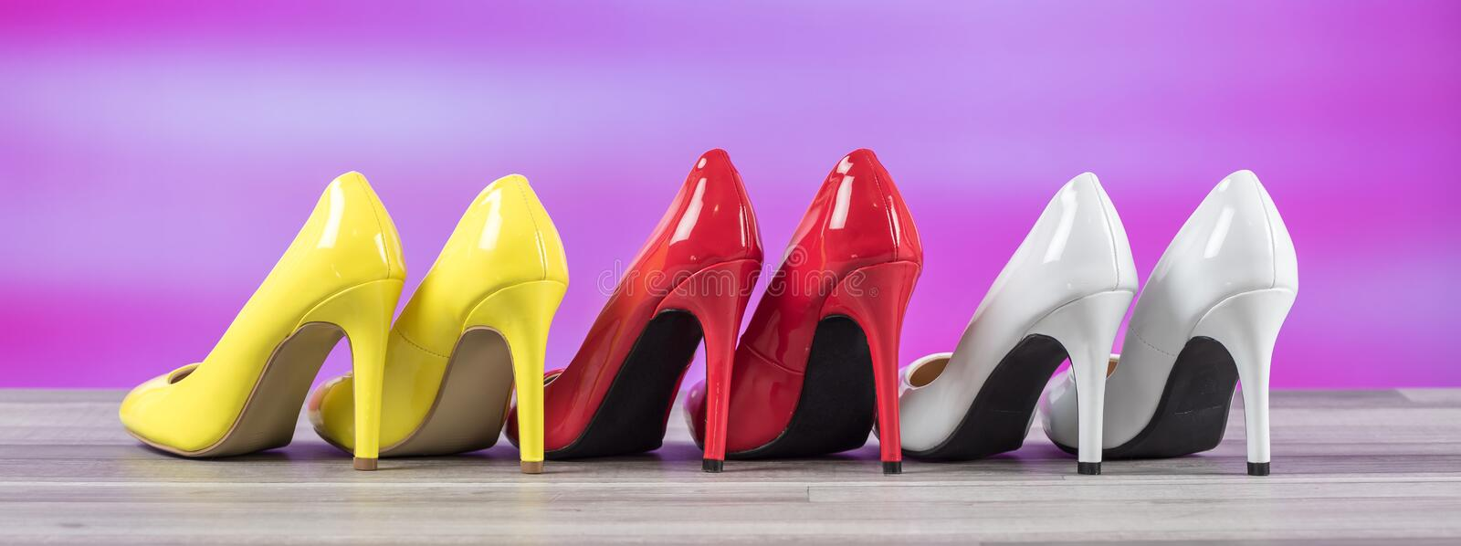 Yellow, white and red high heel shoes stock photography
