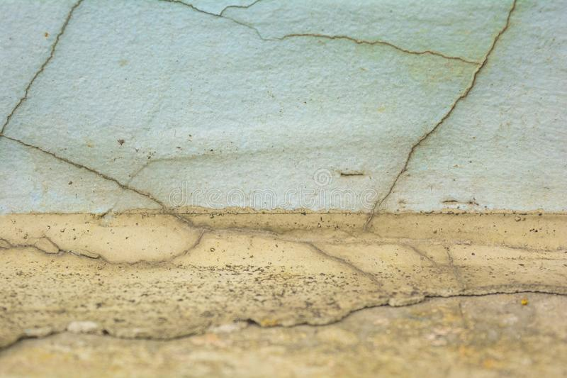 Yellow and white rough concrete wall with cracks royalty free stock photos
