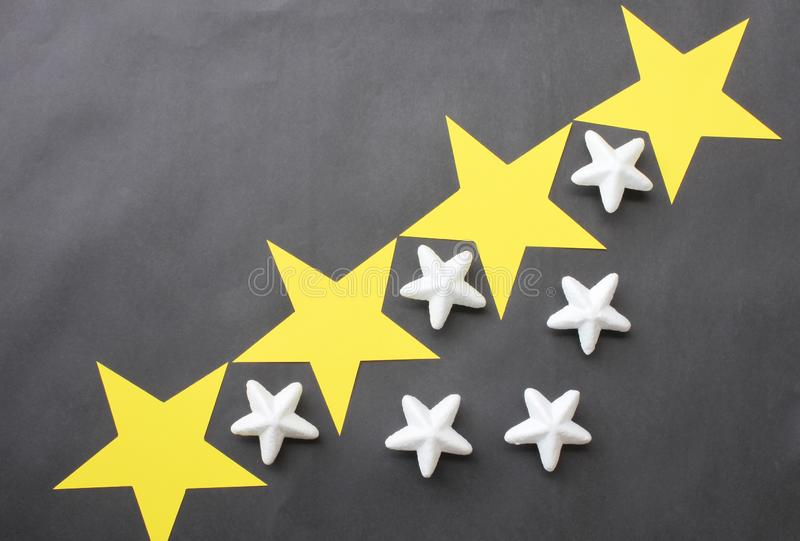 Yellow and white stars are placed on a black background for business ideas and have copy space. stock photos