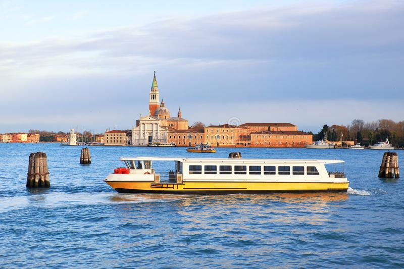 Yellow and white tourist boat in the lagoone by Venice, Italy stock image