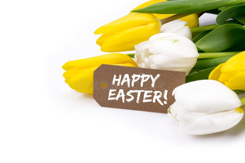Yellow And White Tulips With Happy Easter Card On White Background royalty free stock photos