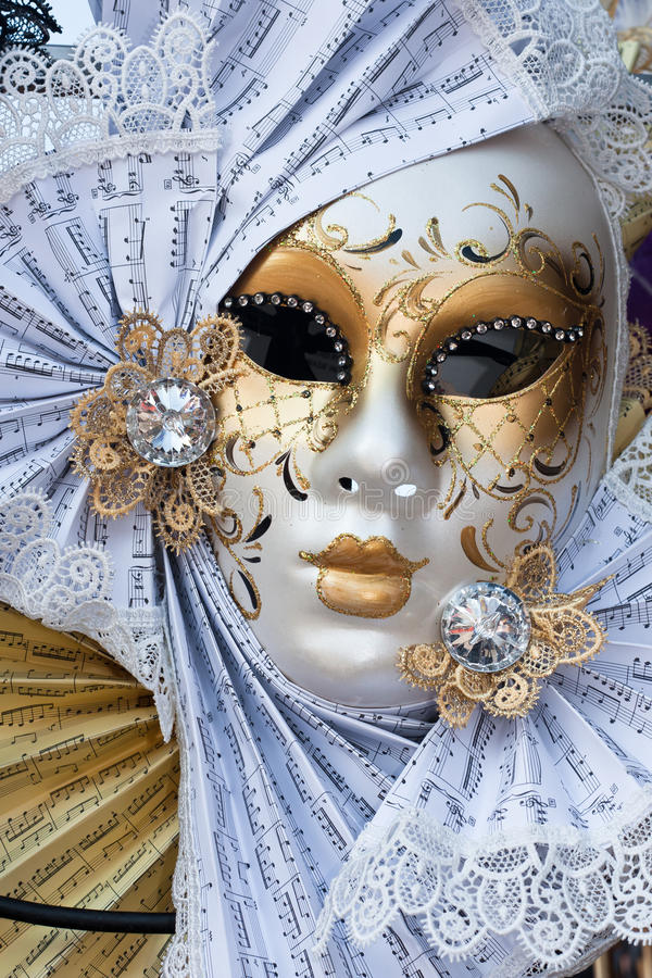 Yellow and white venice carnival mask royalty free stock photography