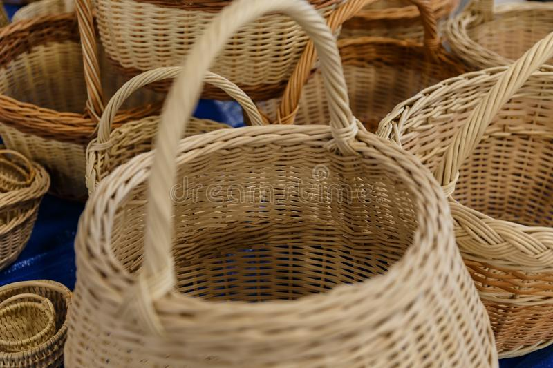 Yellow wicker baskets. For sale in a shop royalty free stock photo