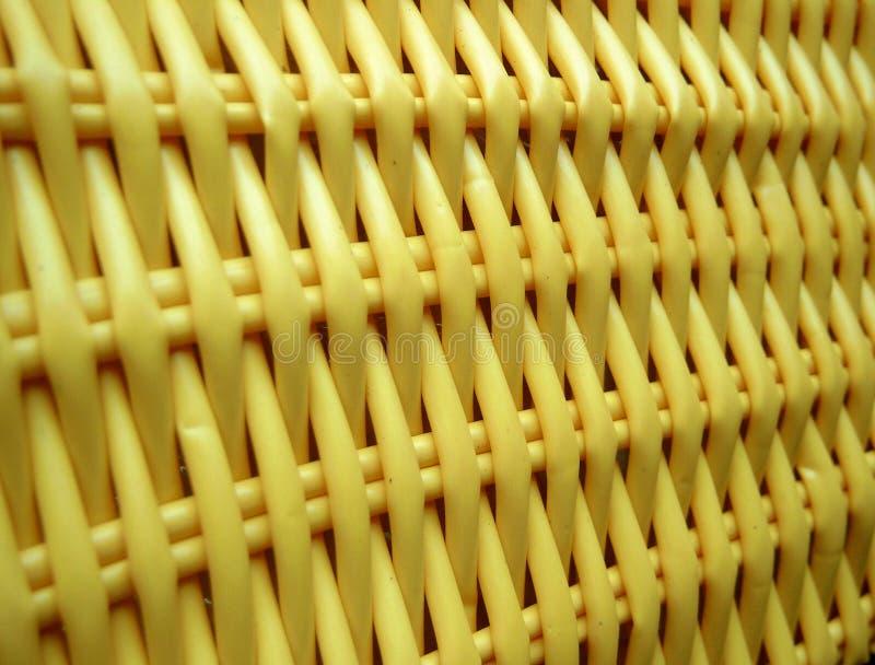 Yellow wickerwork. Plastic yellow wickerwork stock photos