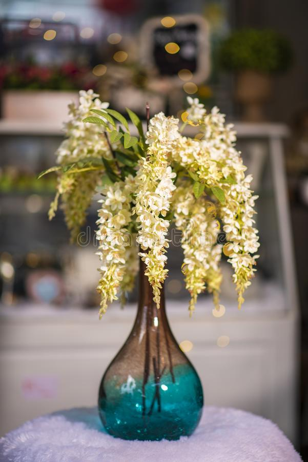 Yellow willow flowers in beautiful vase used for home decoration stock photo