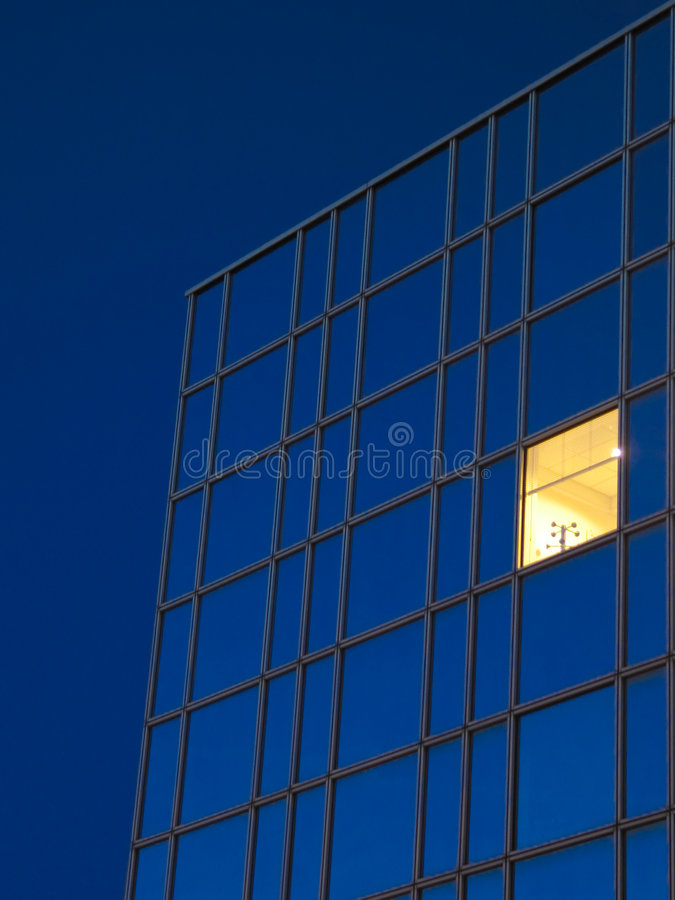 Yellow Window Blue Sky 2. A yellow window in a royal blue office building against a royal blue sky stock image