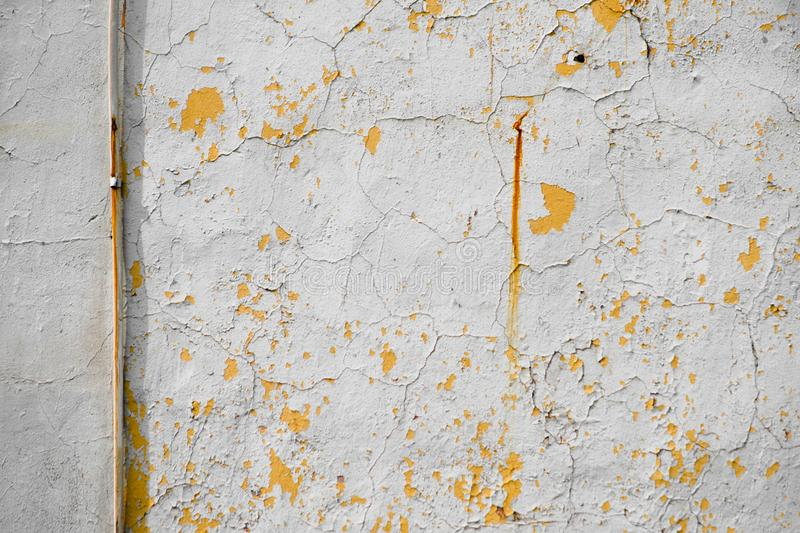 Yellow wire on an old wall with peeling plaster stock photos