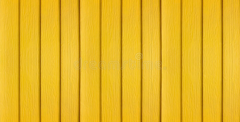 A Banner Background Made Of Yellow Painted Wood
