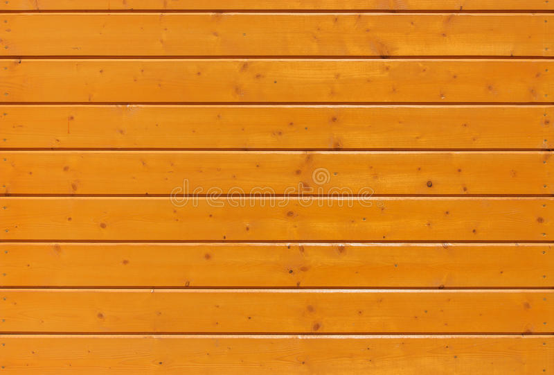 Yellow wood plank under the lackuer with nails royalty free stock photos