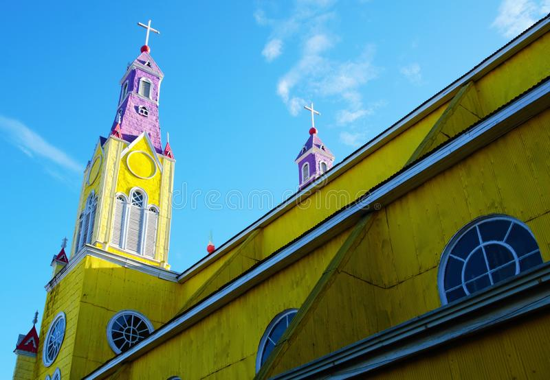 Yellow wooden church in Castro. Close-up of the yellow and purple church in Castro on the island Chilo royalty free stock photography