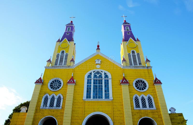 Yellow wooden church in Castro. Close-up of the yellow and purple church in Castro on the island Chilo stock photos