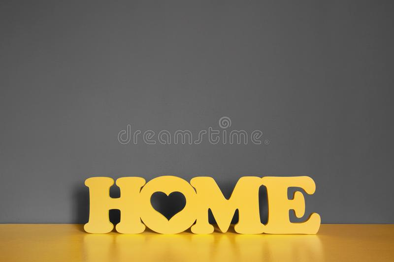 Yellow wooden inscription `house` on a yellow vintage wooden chest stock photo