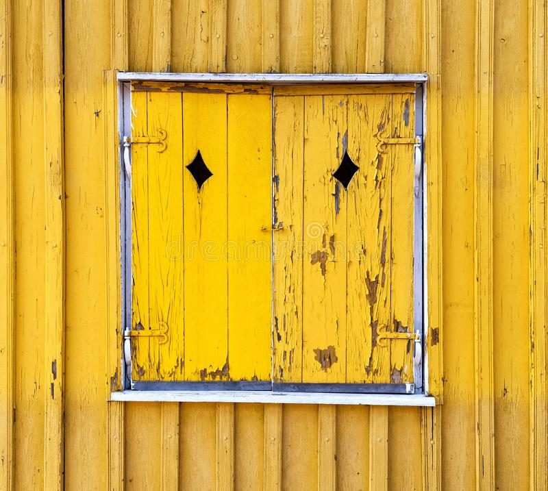 Yellow wooden painted window shutters, background texture stock photography