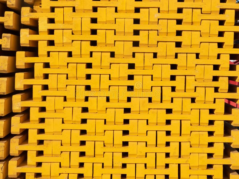 Yellow wooden piled formwork beams. Construction equipment stock images
