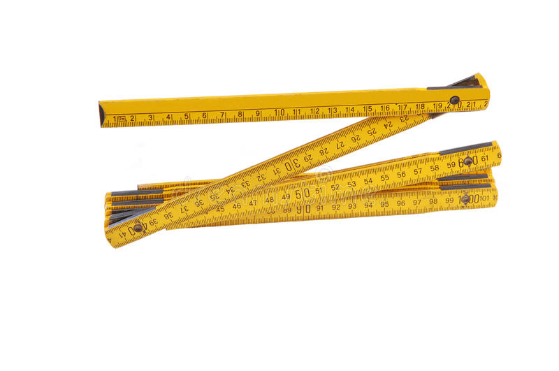 Yellow wooden ruler. An fold able yellow European ruler, two meter long, on white background stock photo