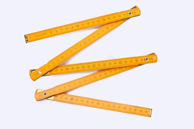 Yellow wooden ruler isolated on white background. Wooden centimeter ruler. Carpenters tool royalty free stock photos