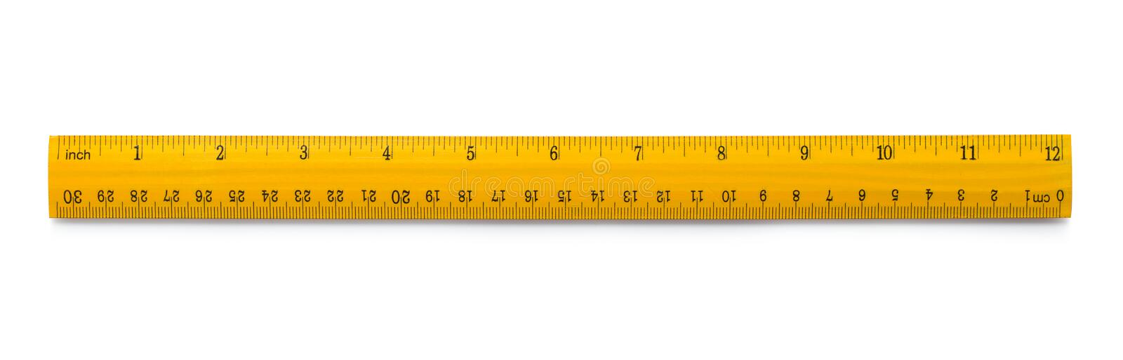 Yellow wooden ruler. Picture of yellow wooden ruler isolated on white background royalty free stock photography