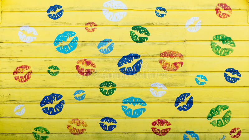 Lips - Yellow wooden wall background - love and freedom concept stock images