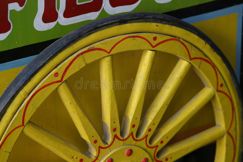 Yellow wooden wheel stock image