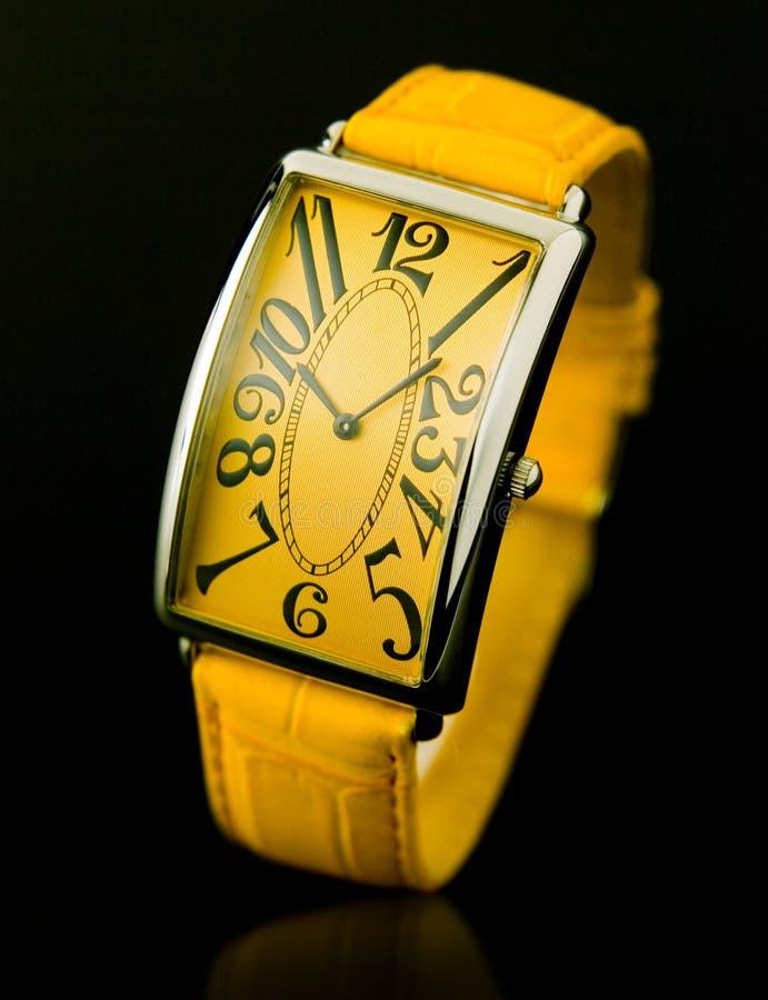 Yellow wristwatch royalty free stock photos