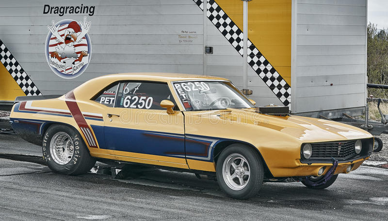 Yellowish blue racing car side view stock image