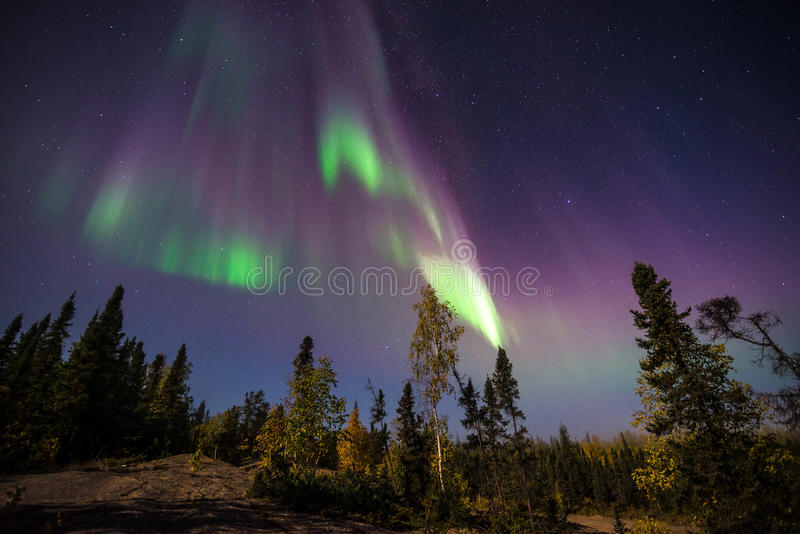 Yellowknife Aurora Borealis 2. The Aurora Borealis or better known as the Northern lights shine over Vee Lake near Yellowknife, Northwest Territories of Canada royalty free stock images