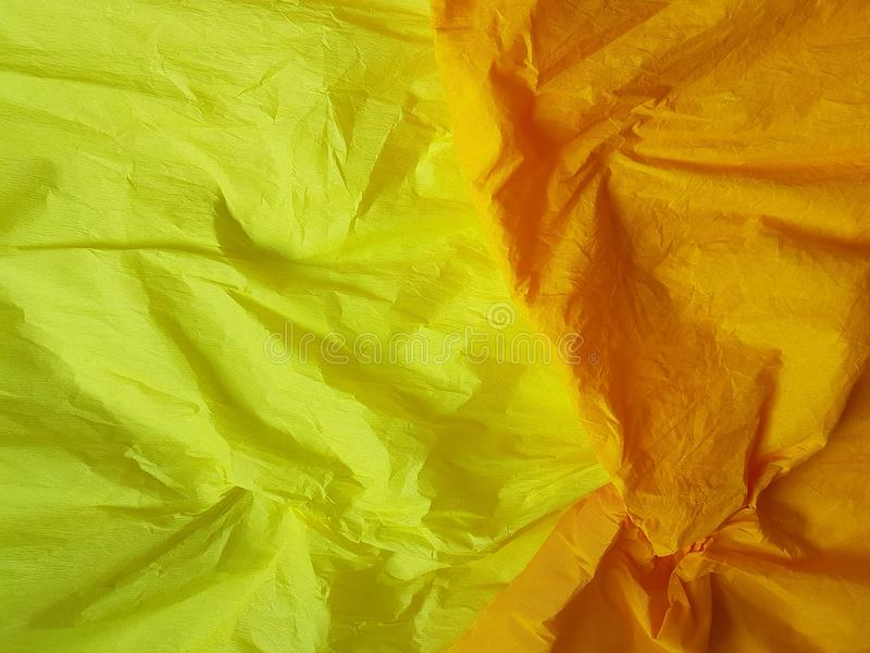 Yelloworange paper background silk surface empty blank sheets vivid colors. Yellow orange paper background silk surface empty blank sheets vivid colors wrapping royalty free stock photos