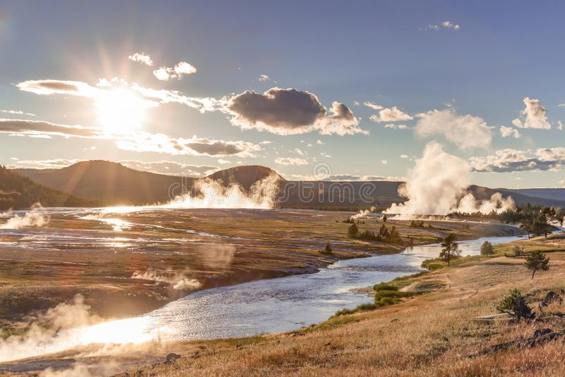 Yellowstone Midway Geyser Basin at sunset. Late evening view of steam rising from the many hot springs of Midway Geyser Basin in Yellowstone National Park royalty free stock photography
