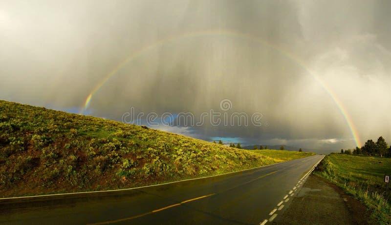 Yellowstone national park rainbow. Yellowstone national park beautiful rainbow in the middle of the road stock image
