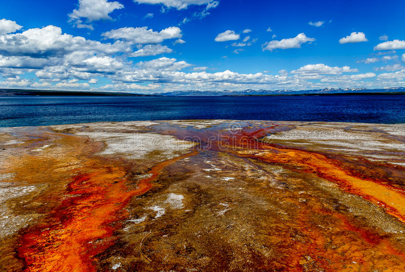 Yellowstone National Park West Thumb Basin. Water and mud turn brilliant colors as a result of geologic activity in Yellowstone's West Thumb Basin. Acidic runoff royalty free stock photos