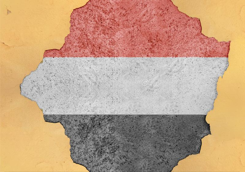 Yemen cracked hole and broken flag in big concrete material facade wall. Yemen cracked hole and broken flag in big concrete material facade structure stock photo