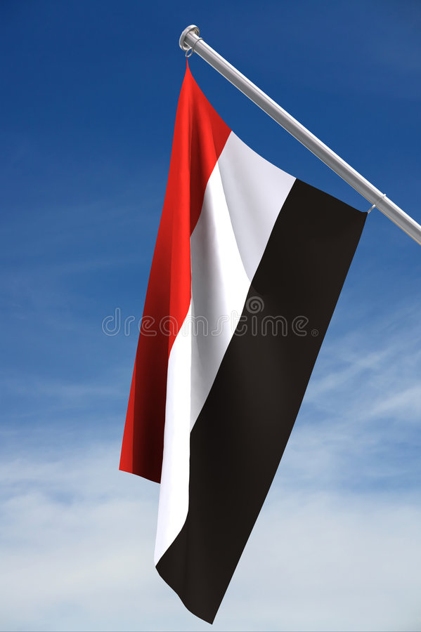 Yemen Flag and a Blue Sky stock photography