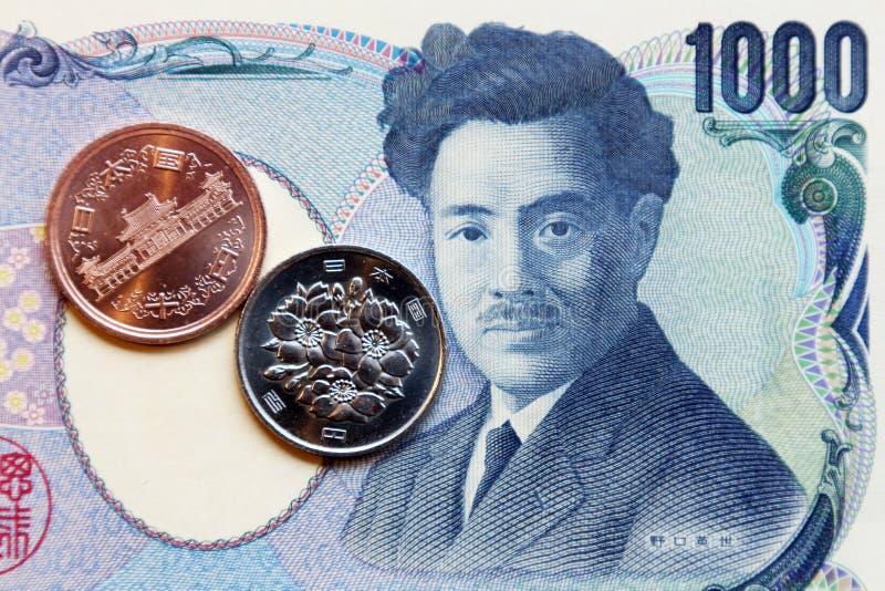 Yen, het muntstukmunt van Japan, muntstukken en bankbiljet stock afbeeldingen