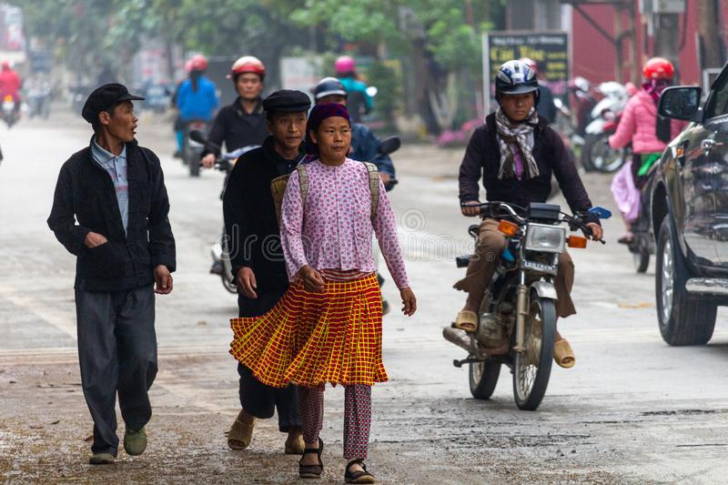 Yen Minh sunday meeting Vietnam. Ha Giang, Vietnam - March 17, 2018: Well dressed Hmong ethnic people from the countryside walking to the sunday market in Yen royalty free stock image
