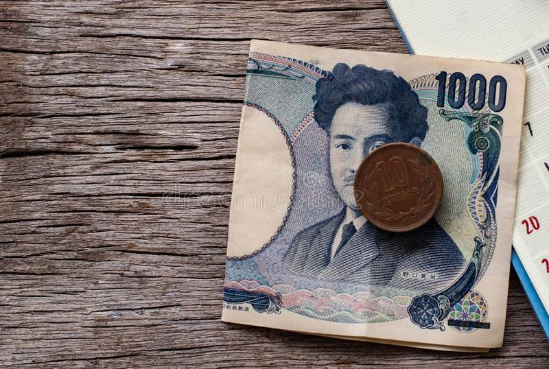Yen notes and yen coins. With calendar in save money concept royalty free stock photo