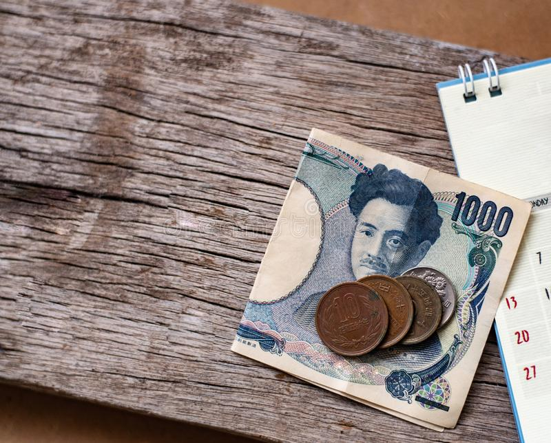 Yen notes and yen coins. With calendar in save money concept royalty free stock photography